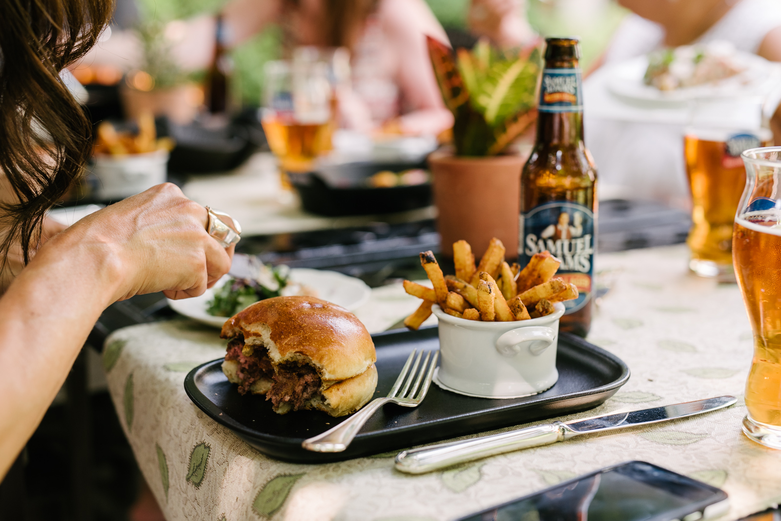 Guests indulging in the burger, beer and fries