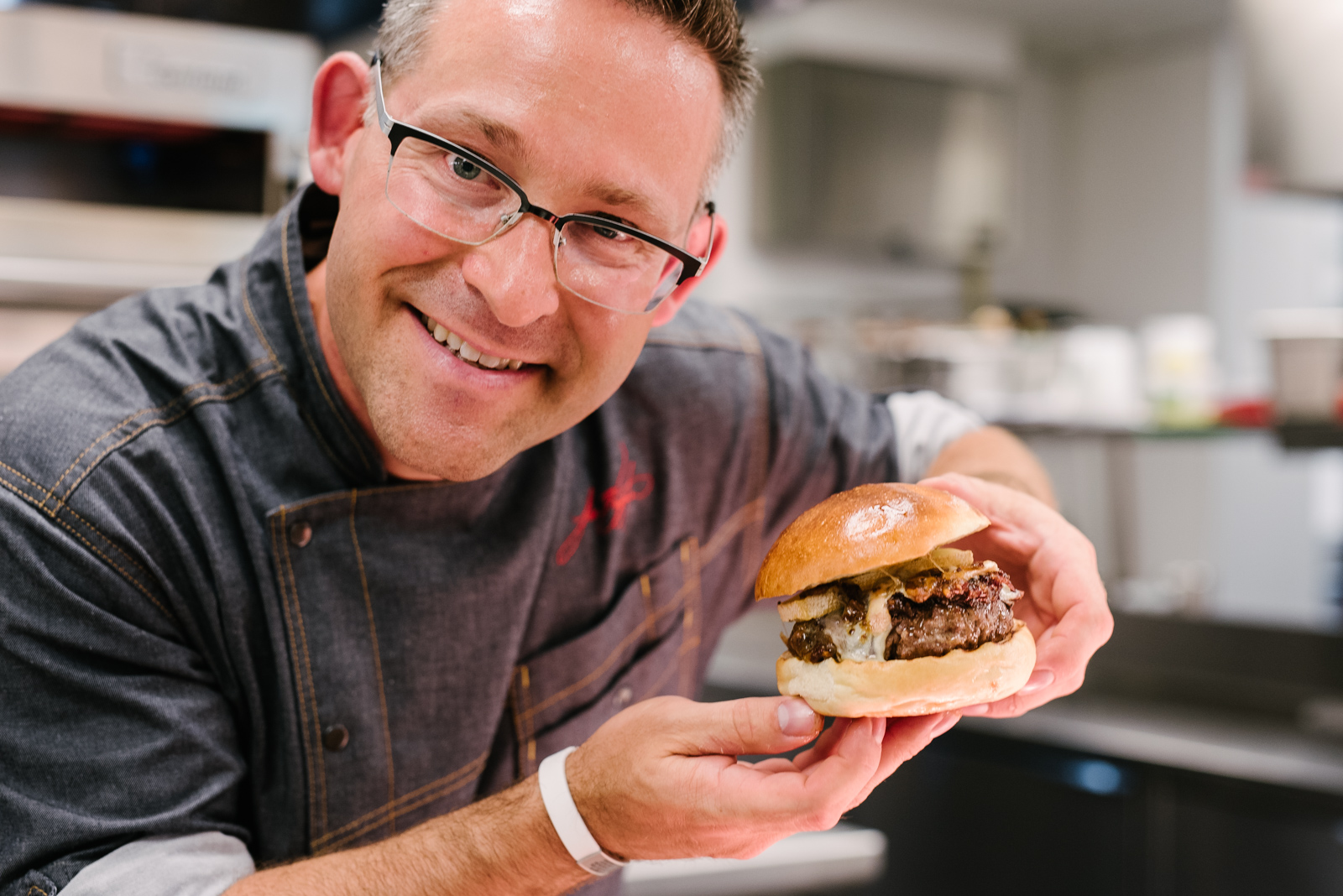 Chef holding his burger proud